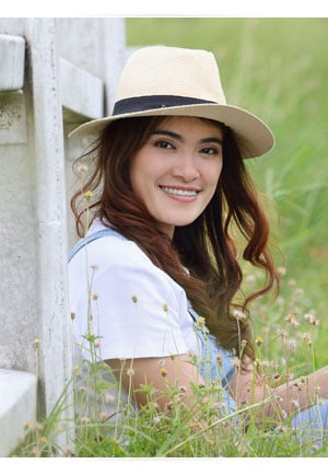 oung Woman in Hat photo in Cedarbaum Orthodontics in Flemington NJ