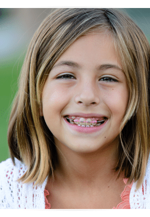 Girl with pink braces photo At Cedarbaum Orthodontics in Flemington NJ
