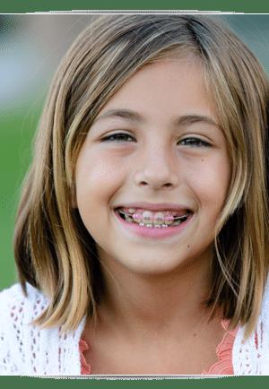 Girl with pink braces photo At Cedarbaum Orthodontics in Flemington NJ